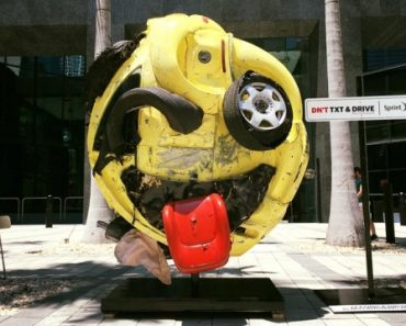Local artist, Rudolf Kohn, transformed a mangled car into an emoji as an anti texting & driving PSA in Miami.